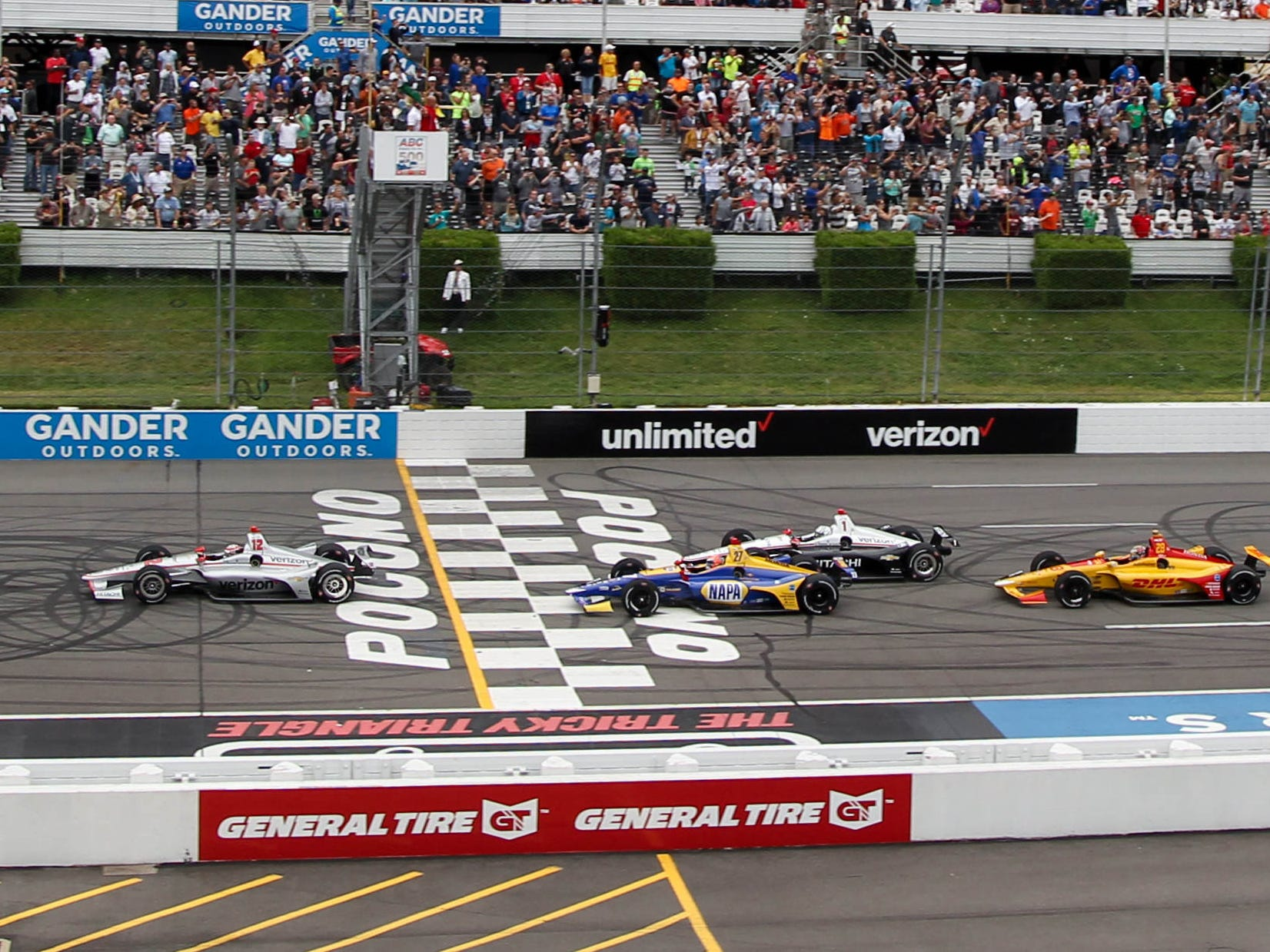 Will Power, front, leads the field to the green flag to start the ABC Supply 500 Sunday at Pocono Raceway.