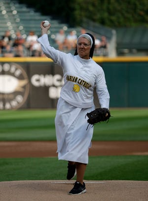 Sister Mary Jo Sobieck throws out a ceremonial first pitch before a game between the Kansas City Royals and the Chicago White Sox.