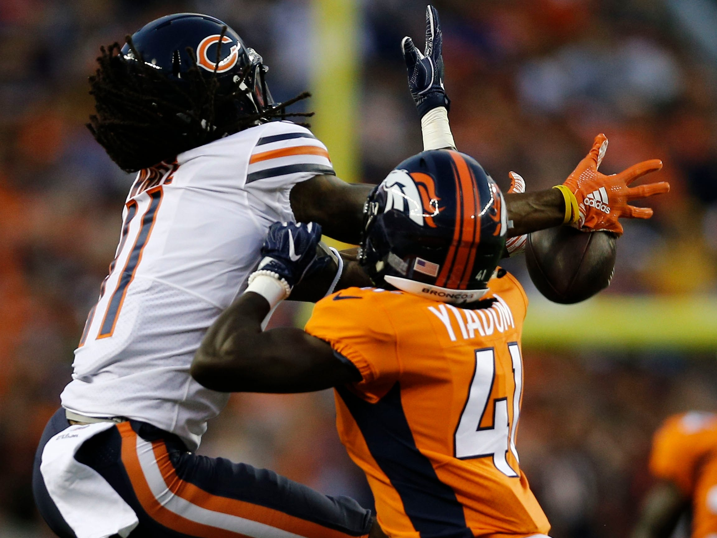 Broncos cornerback Isaac Yiadom (41) breaks up a pass intended for Bears receiver Kevin White (11) during the first quarter.