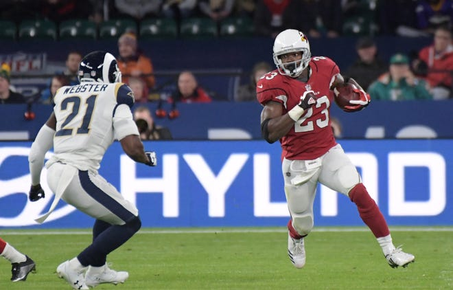 Oct 22, 2017; London, United Kingdom; Arizona Cardinals running back Adrian Peterson (23) run with the football defended by Los Angeles Rams cornerback Kayvon Webster (21) during an NFL International Series game at Twickenham Stadium. Mandatory Credit: Kirby Lee-USA TODAY Sports