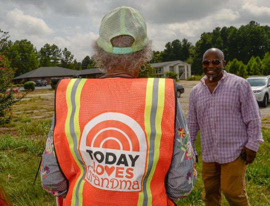 Estella Williams, left, wears her crossing guard vest with the NBC Today Loves Grandma on it, near her son Terrell Williams, before directing traffic in front of Westside High School in Anderson on Monday. Williams, who recently visited New York and was on the Today show, has been a crossing guard for 27 years.