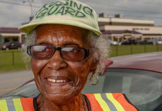 Estella Williams helps direct traffic in front of Westside High School in Anderson on Monday. Williams, who recently visited New York and was on the Today show, has been a crossing guard for 27 years.