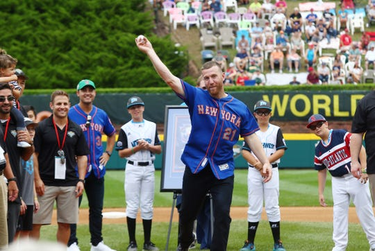 Todd Frazier, member of the 1998 LLBWS Champion Toms River East American Little League team throws out the first pitch at Lamade Stadium at the Little League Baseball World Series. August 19, 2018, South Williamsport, Pa.