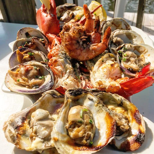 At Red's Lobster Pot in Point Pleasant Beach, the grilled sampler includes a 1-pound lobster, spicy clams, oysters and peel-and-eat shrimp.