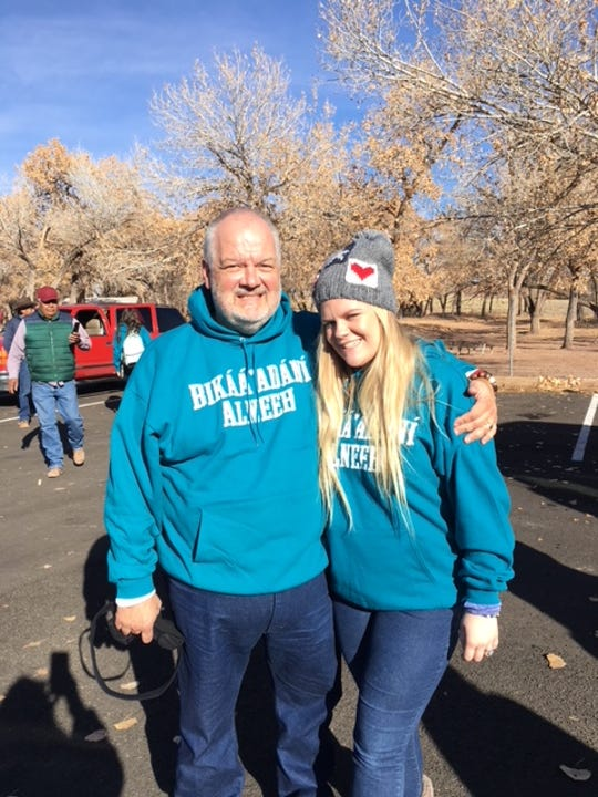 """Cooper High Student Council adviser Jimmy Pogue with daughter Katie, who this year is vice president of the student organization. Their sweatshirts read """"Build the Table, """" a focus on relation-building through sharing a common meal. They are pictured at Canyon de Chelly near Chinle, Arizona."""