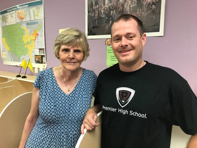 Sue Pond, Premier High School campus director, and J. P. Reeves, lead teacher and assistant campus director of Premier High School, are ready for school to start on Wednesday.