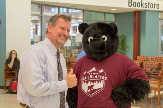 A-B Tech's new Trailblazer Bear mascot meets Terry Brasier, Vice President of Student Services at the college, on Monday.