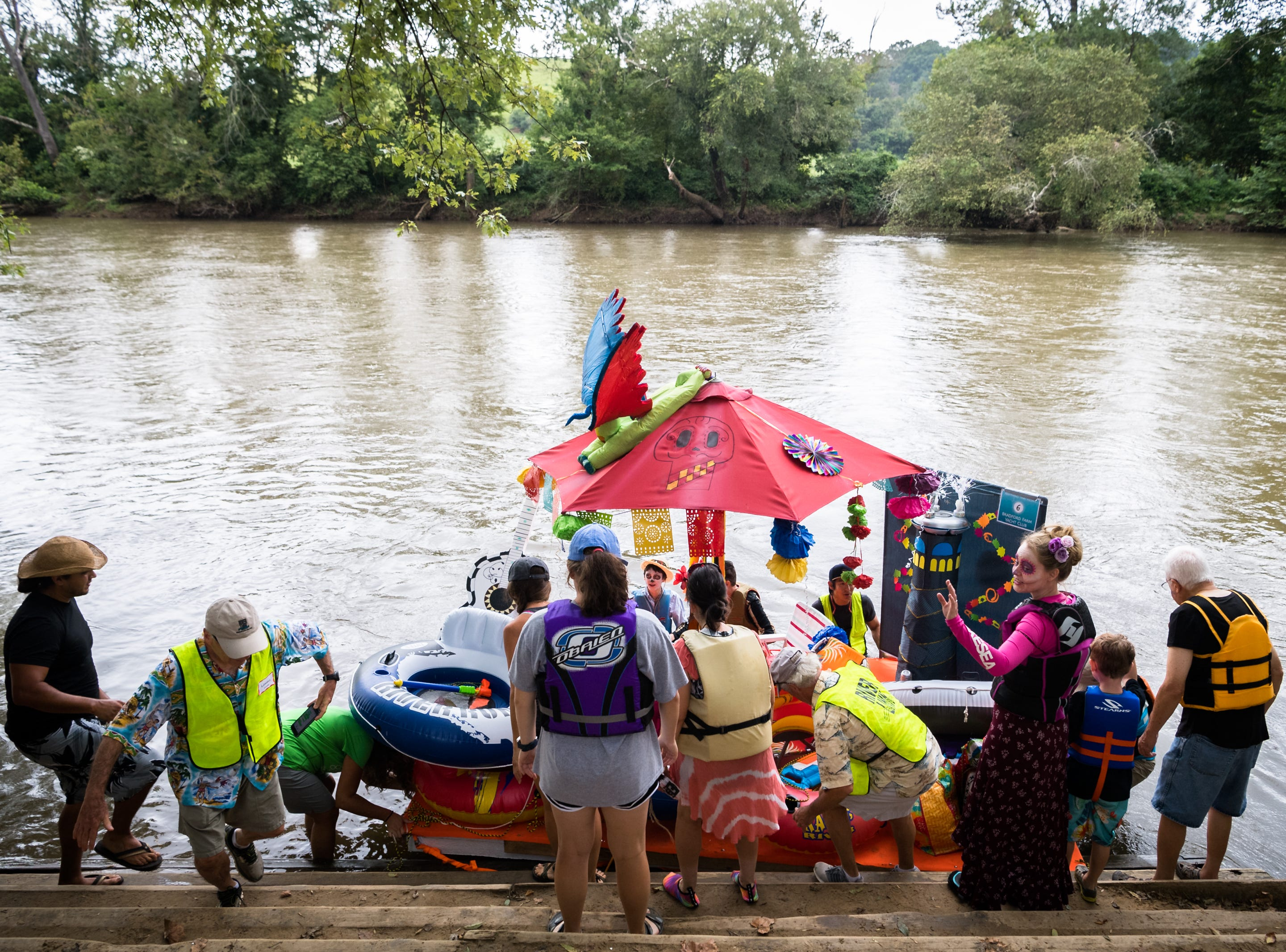 The Bradford Farm Yacht Club Anything that Floats parade team prepares to float down to New Belgium Brewing where RiverLink's RiverFest took place Saturday, August 18, 2018.