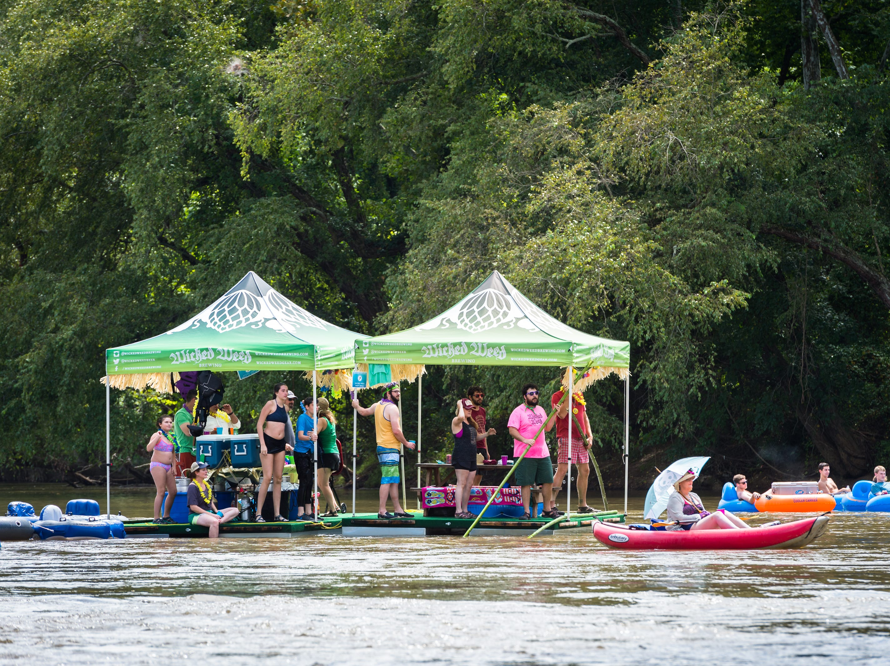 The Wicked Weed Brewing Anything that Floats parade team makes its way down the French Broad River to New Belgium Brewing where RiverLink's RiverFest took place Saturday, August 18, 2018.