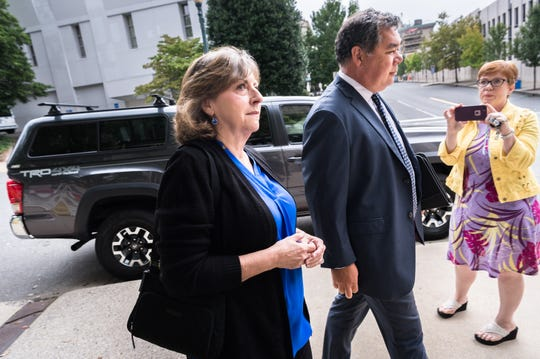 Wanda Greene, former Buncombe County manager, arrives at federal court with her attorneys Noell Tin and Thomas Amburgey, Monday, August 20, 2018, to enter a plea for her charges of 29 counts of wire fraud, one count of conspiracy to defraud the federal government, one count of receipt of bribes and kickbacks, and one count of federal program fraud. Greene has also been charged with six counts of tax fraud in connection to a life insurance scheme and embezzlement alleged by prosecutors in previous indictments.
