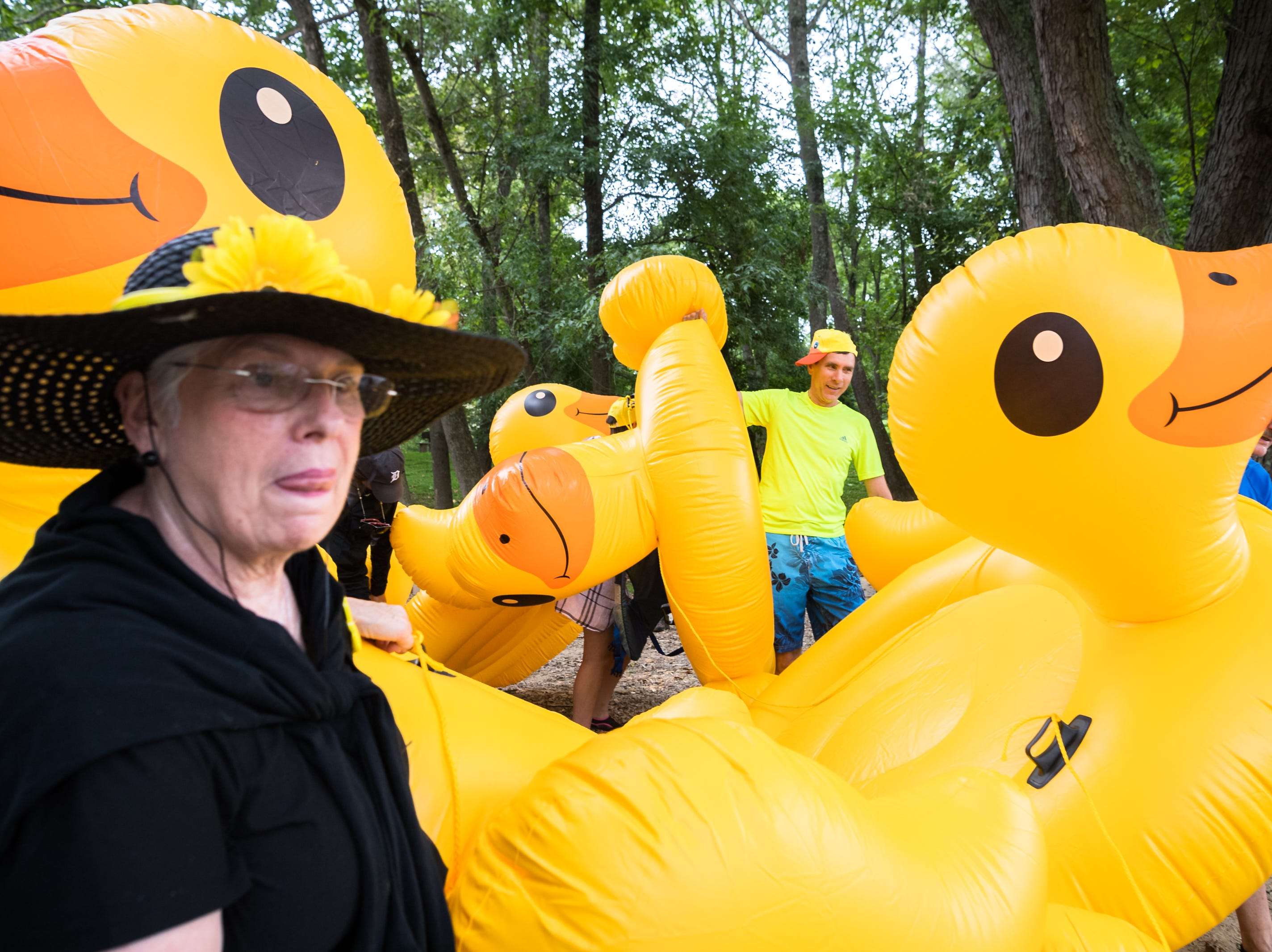 Team members from the Just Ducky Anything that Floats parade team, wait to put in to the French Broad River at Hominy Creek River Park, Saturday, August 18, 2018. The parade ended at New Belgium Brewery where RiverLink's RiverFest took place.