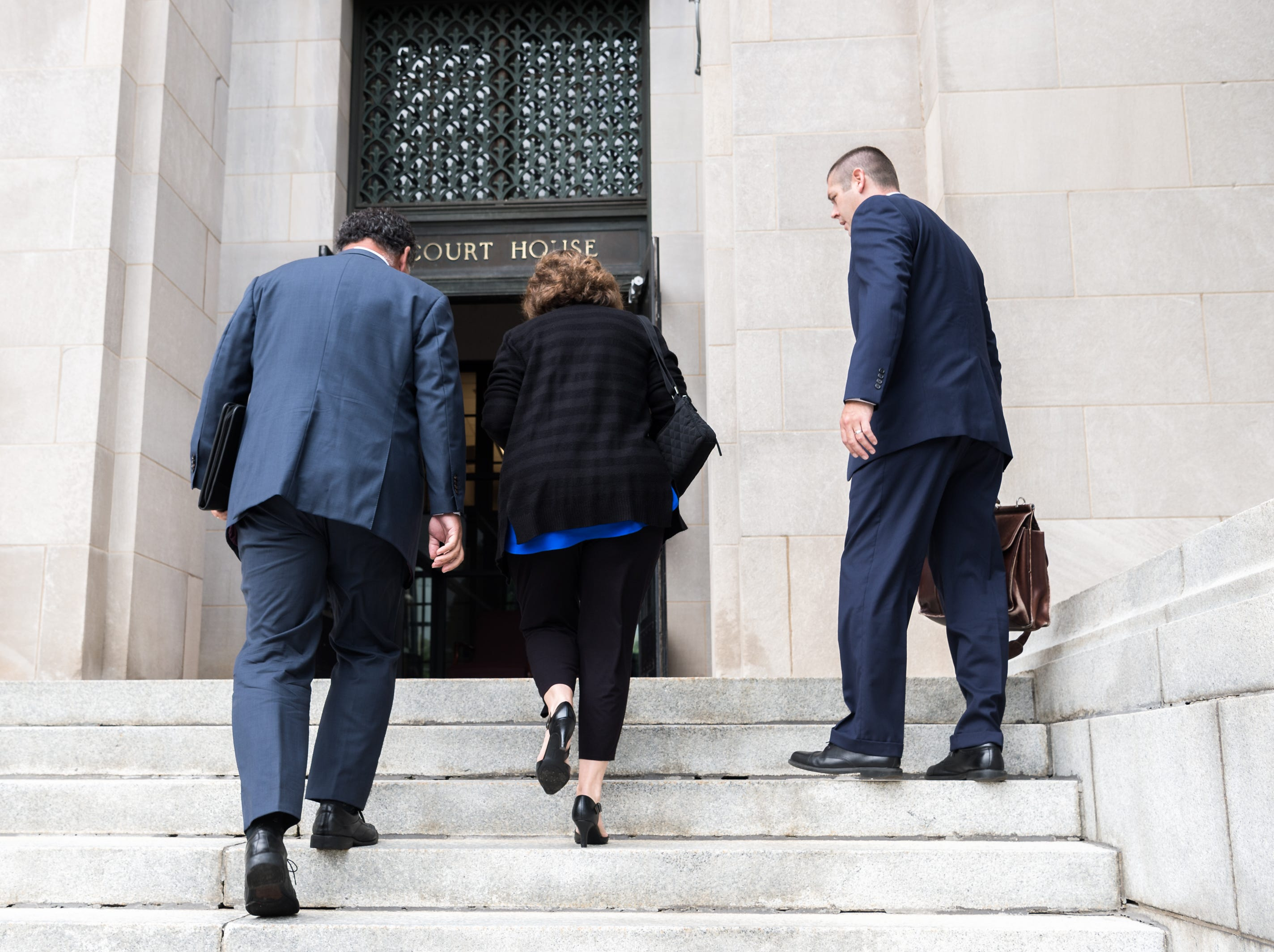 Wanda Greene, former Buncombe County manager, arrives at federal court with her attorneys Noell Tin and Thomas Amburgey Monday, August 20, 2018, to enter a plea for her charges of six counts of tax fraud in connection to a life insurance scheme and embezzlement alleged by prosecutors in previous indictments. Greene, as well as her son Michael Greene have additionally been charged with wire fraud, conspiracy, embezzlement and aiding and abetting.