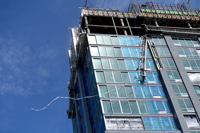 A scaffolding platform hangs almost vertically from the construction site on the West side of The Arras, the former BB&T building, downtown on Monday, Aug. 20, 2018.