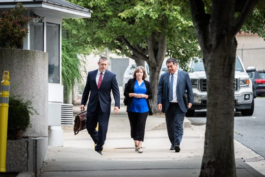 Wanda Greene, former Buncombe County manager, arrives at federal court with her attorneys Thomas Amburgey and Noell Tin Monday, August 20, 2018, to enter a plea for her charges of six counts of tax fraud in connection to a life insurance scheme and embezzlement alleged by prosecutors in previous indictments. Greene, as well as her son Michael Greene have additionally been charged with wire fraud, conspiracy, embezzlement and aiding and abetting.