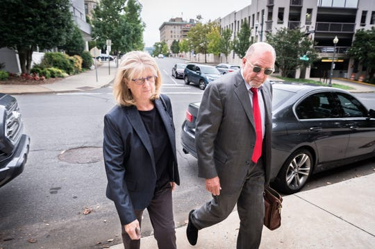 Mandy Stone, former Buncombe County manager, arrives at federal court with her attorney, Jack Stewart Monday, August 20, 2018, to enter a plea for her charges of 29 counts of wire fraud, one count of conspiracy to defraud the federal government, one count of receipt of bribes and kickbacks, and one count of federal program fraud.