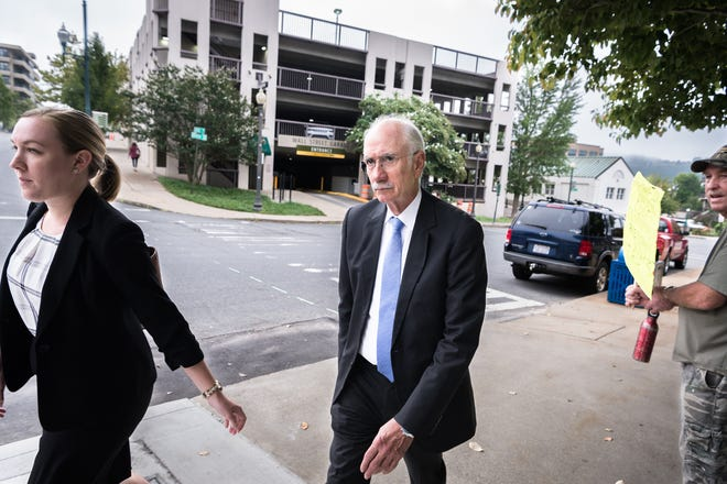 Jon Creighton, former Buncombe County assistant county manager, arrives at federal court to enter a plea for his charges of 29 counts of wire fraud, one count of conspiracy to defraud the federal government, one count of receipt of bribes and kickbacks, and one count of federal program fraud.