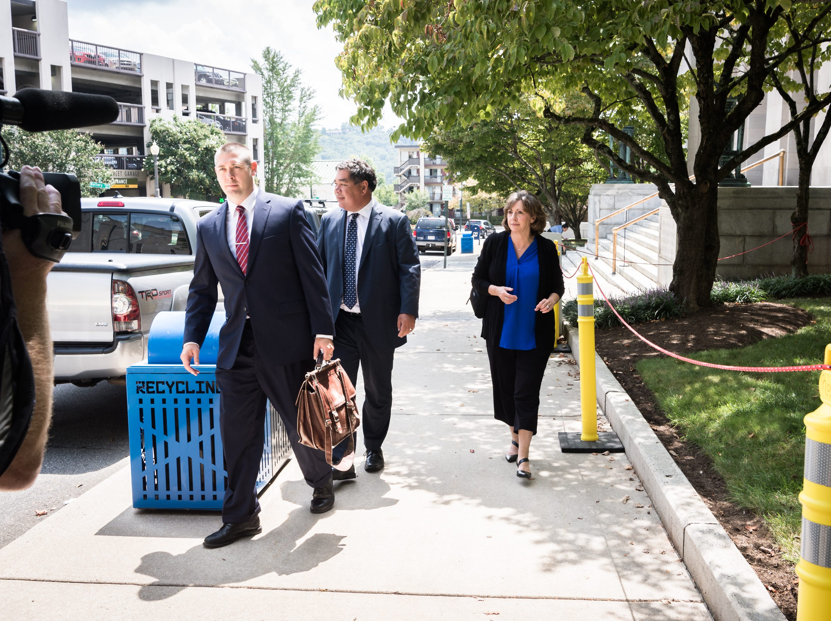 Wanda Greene, former Buncombe County manager, leaves the federal courthouse with her attorneys Noell Tin and Thomas Amburgey, Monday, August 20, 2018, after being arraigned on charges of six counts of tax fraud in connection to a life insurance scheme and embezzlement alleged by prosecutors in previous indictments. Greene, as well as her son Michael Greene have additionally been charged with wire fraud, conspiracy, embezzlement and aiding and abetting.
