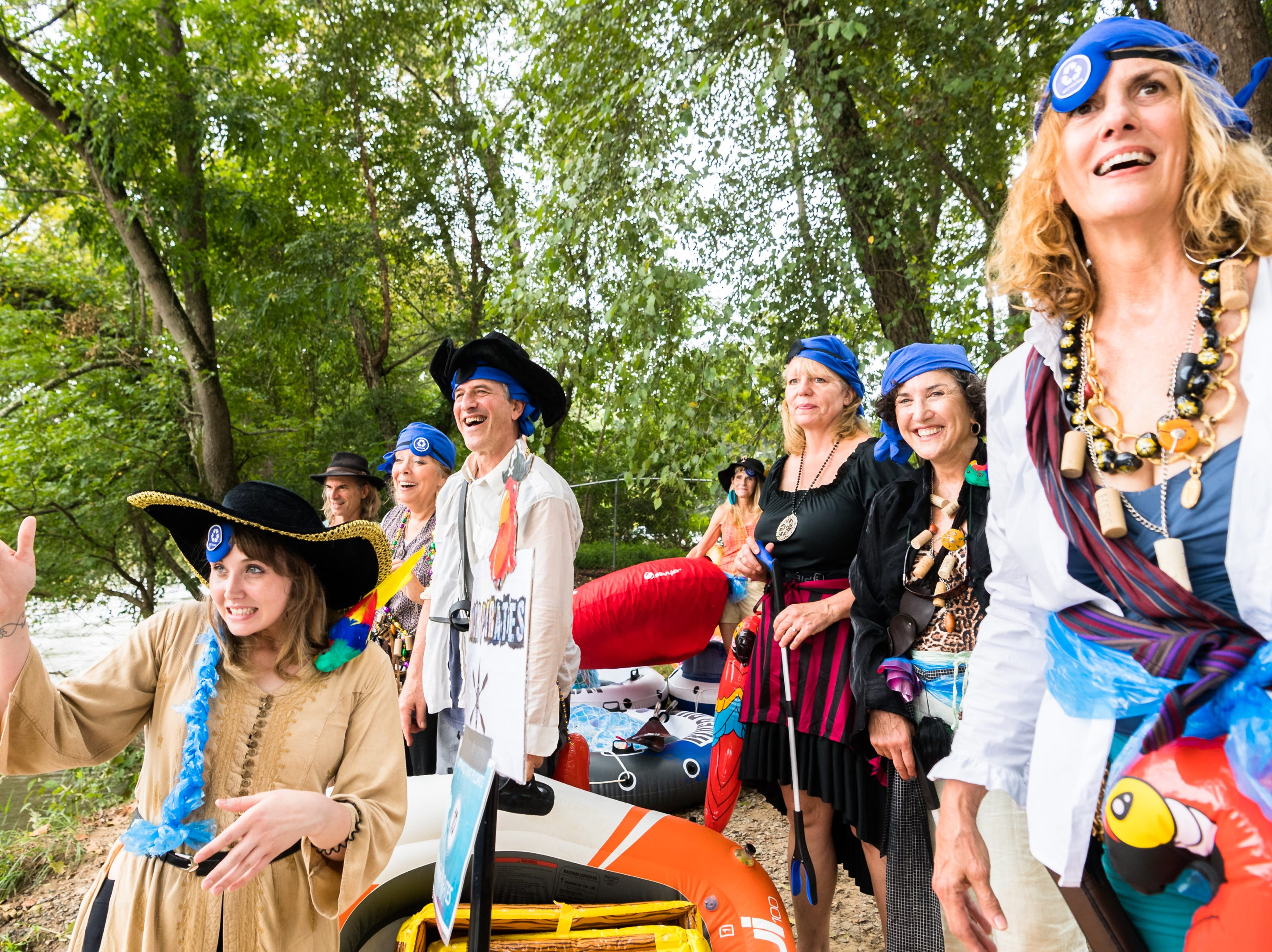 The Trash Pirates Anything that Floats parade team watches another team launch before floating down to New Belgium Brewing where RiverLink's RiverFest took place Saturday, August 18, 2018.