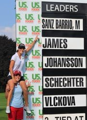 Marta Sanz Barrio points at the leaderboard after winning the FireKeepers Casino Hotel Championship at Battle Creek Country Club on Sunday.