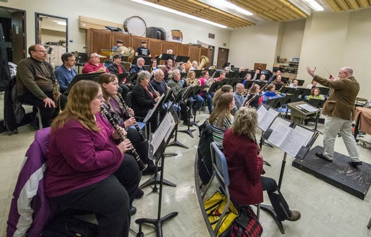 Samuel McIlhagga leads members of the Cereal City Concert Band during a rehearsal in 2014.