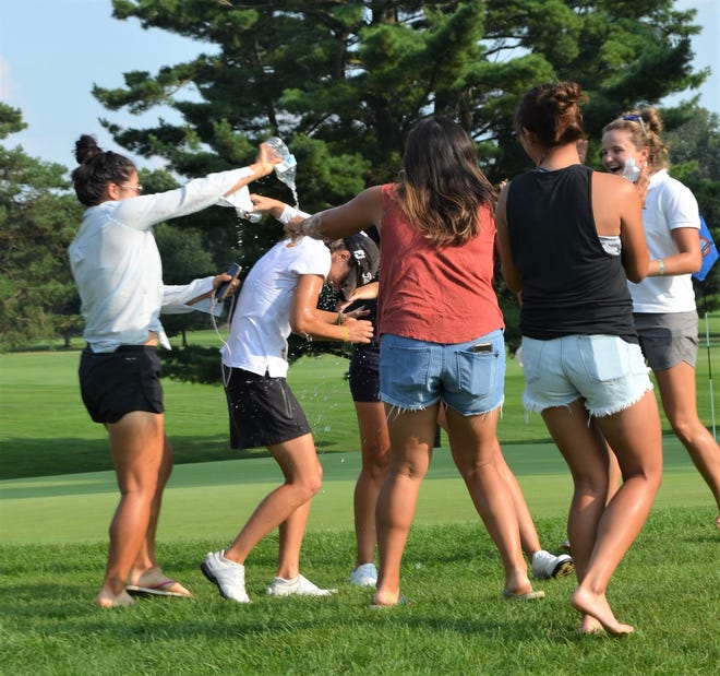 As per tradition Symetra Tour players celebrate with Marta Sanz Barrio by dumping water on her head following her championship at the FireKeepers Casino Hotel Championship at Battle Creek Country Club on Sunday.