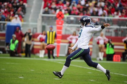 Jon Ryan punts during a game last November against the San Francisco 49ers. The Seahawks released Ryan, their longest-tenured player, on Monday.