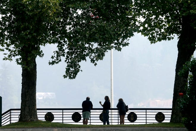 Wildfire smoke almost obscures the opposite shore of Dyes Inlet from Silverdale Waterfront Park on Monday.