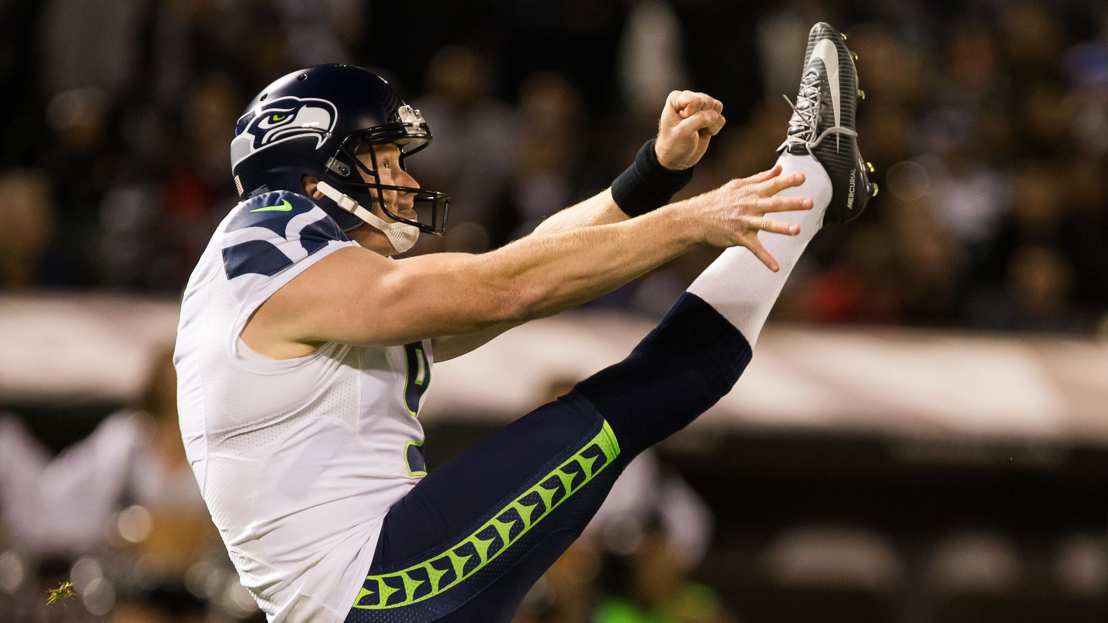 Jon Ryan punts during a 2016 game against the Oakland Raiders. Ryan, the longest-tenured Seattle Seahawk, was released on Monday.
