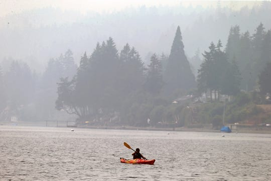Wildfire smoke didn't stop this kayaker in Dyes Inlet off Silverdale Waterfront Park on Monday.