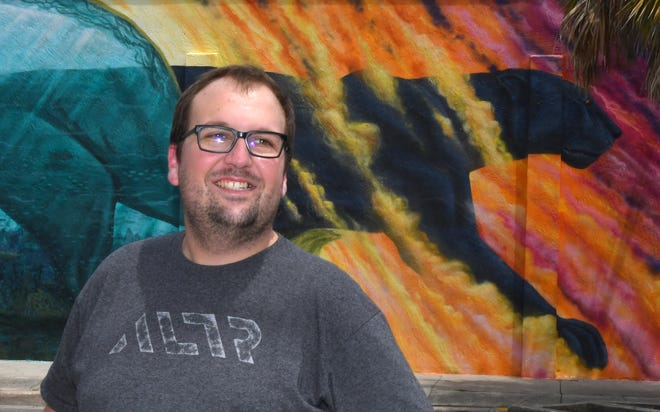 Chris Struttmann, founder, director of engineering, and chief architect of ALTR will have an August 22 Founder Talk at Groundswell Startups,in Melbourne. In the background is the panther mural by artist Christopher Maslow in downtown Melbourne.