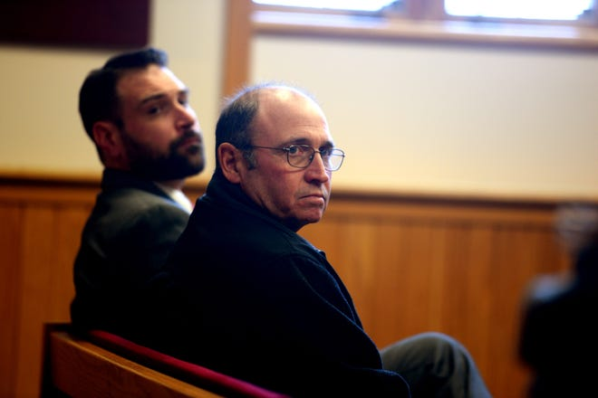 Former South Royalton School principal Dean Stearns, right, sits with his attorney Michael Shane in Windsor Superior Court in White River Junction, Vt., on March 19, 2018. Stearns pleaded not guilty to  several charges of voyeurism and promoting sexual recordings. (Valley News - Jennifer Hauck) Copyright Valley News. May not be reprinted or used online without permission. Send requests to permission@vnews.com.