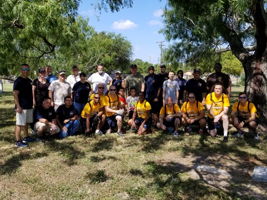 Volunteers  in the cemetery cleanup included Naval Air Station Corpus Christi volunteers and other local people.