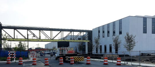 A 225-foot pedestrian bridge will allow Subaru of America employees to walk over Newton Avenue at the company's campus in Camden.