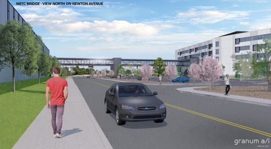 A pedestrian bridge will connect Subaru of America headquarters in Camden with a training center on the opposite side of Newton Avenue.