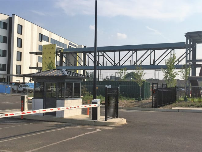 A bridge will carry workers between two buildings at Subaru of America's Camden campus.