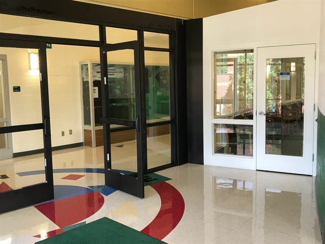 The doors on the newly installed glass wall in the left of this photo will be locked during the school day to make sure visitors to Huntington Elementary School have to go through the office door shown at right. Upgrading security is a focus of a school safety levy that voters in five of Butler County's 10 districts are being asked to approve Nov. 6, 2018.