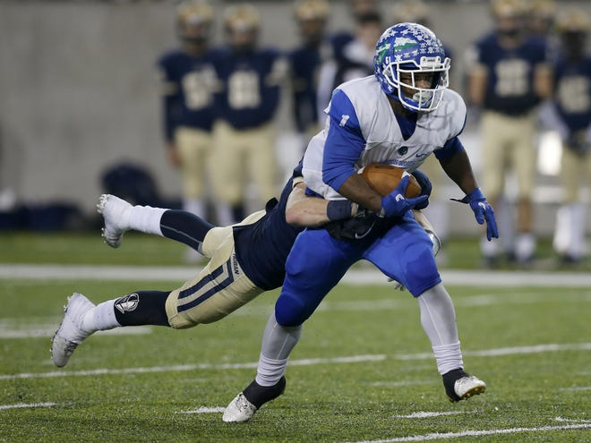 Winton Woods Warriors  receiver Cornell Beachem Jr (1) fights off a tackle after a catch in the fourth quarter of the OHSAA Div. II State Championship game between Archbishop Hoban and Winton Woods at Tom Benson Hall of Fame Stadium in Canton, Ohio, on Thursday, Nov. 30, 2017. Hoban held on to a wide halftime lead to clinch the state title, 42-14, over Winton Woods.