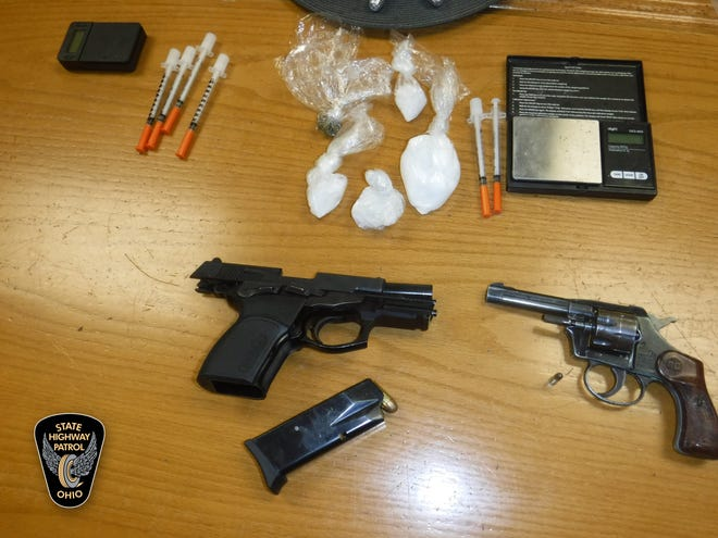 Ohio State Highway Patrol troopers seized two handguns and 70 grams of methamphetamine during a routine traffic stop.