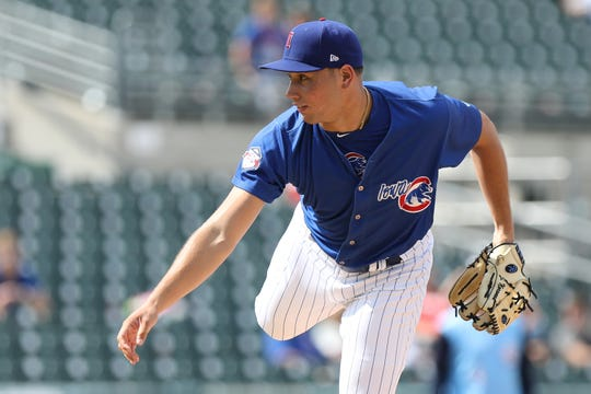 James Norwood throws a pitch for the Iowa Cubs.