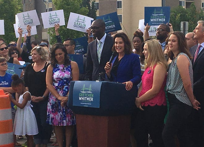 Michigan democratic gubernatorial candidate Gretchen Whitmer introduces Garlin Gilchrist II as her running mate in Lansing on Monday, Aug. 20, 2018.