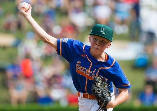 Grosse Pointe Woods-Shores pitcher Preston Barr (12) throws a pitch in a game against Iowa during Woods-Shores' 5-4 win in an elimination baseball game in United States pool play at the Little League World Series tournament in South Williamsport, Pa., Monday, Aug. 20, 2018.