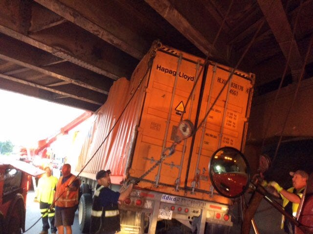 Crews work to upright an overturned semi truck on I-94 on August 20, 2018.