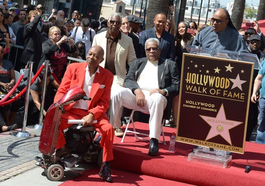 Eddie Willis, left and Jack Ashford, center, look on as Stevie Wonder speaks, right, during a ceremony honoring the musicians with a star on the Hollywood Walk of Fame on March 21, 2013 in Hollywood, California.The Funk Brothers was the nickname of Detroit, Michigan, session musicians who performed the backing to most Motown recordings from 1959 until the company moved to Los Angeles in 1972.