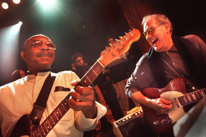 Funk Brothers band guitar players Eddie Willis, left, of Grenada, Mississippi, and  Joe Messina, right, of Warren, share a laugh during rehearsal at the Royal Oak Music Theatre, in Royal Oak on Friday, December 8, 2000.