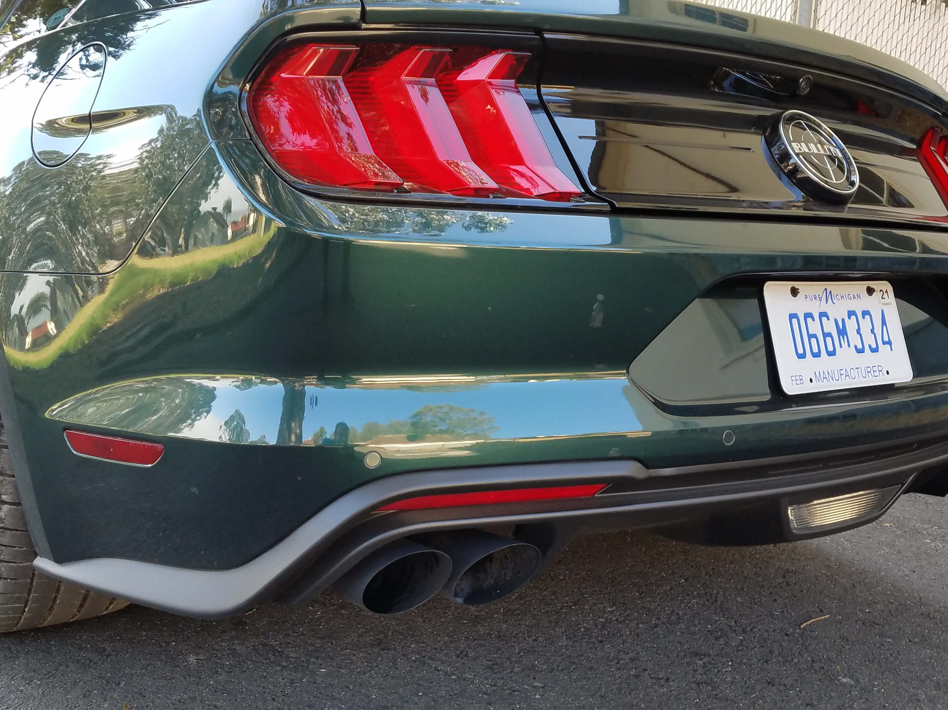 """With its """"Bullitt"""" badge and cut, quad tailpipes, the 2019 Ford Mustang Bullitt is unmistakable from the rear. Oh, yeah — and it's Highland Green, just like the movie car."""