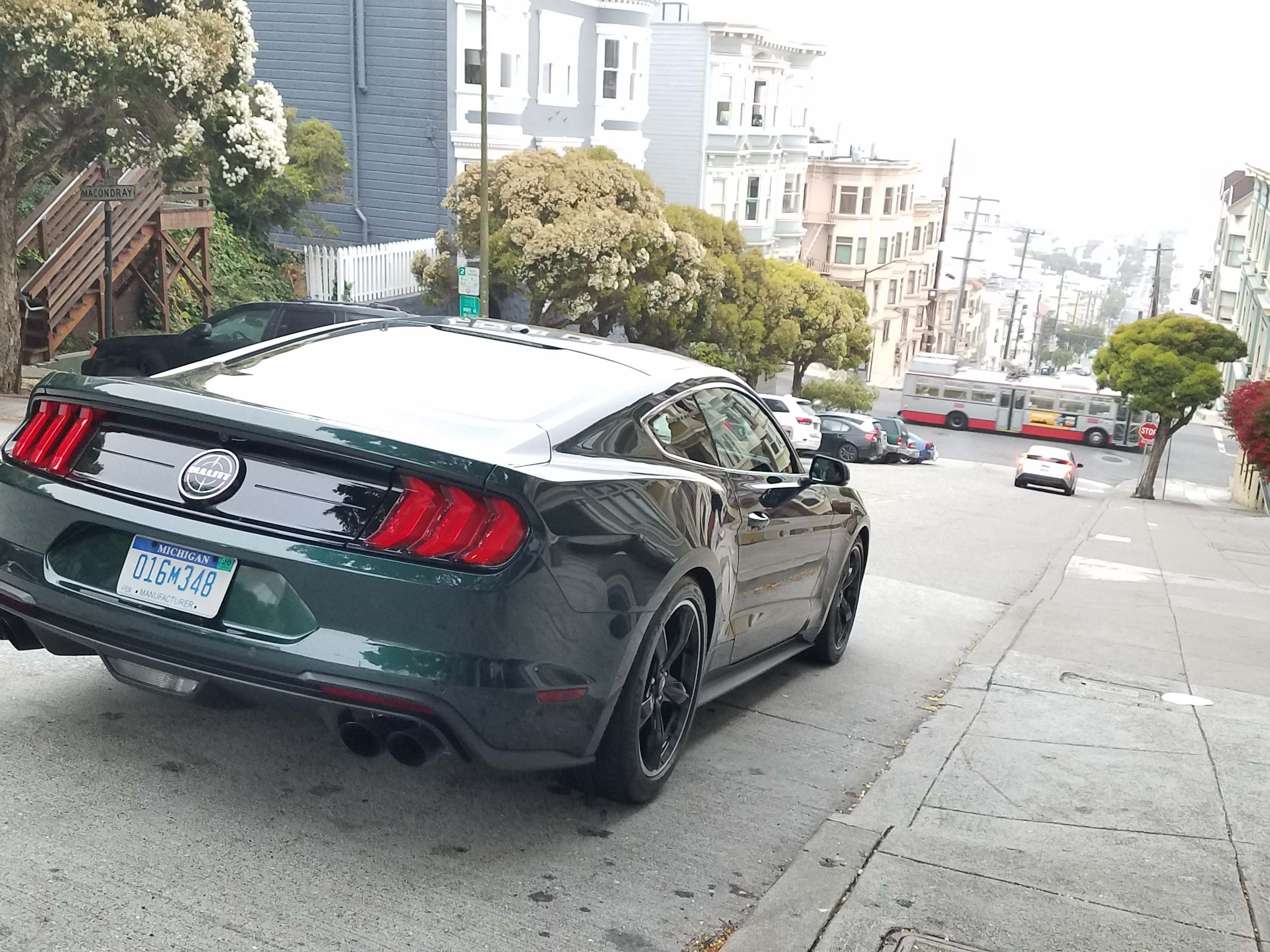 """A 2019 Ford Mustang Bullitt stares down Taylor Street on Russian Hill overlooking San Francisco Bay. The street was featured in the """"Bullitt"""" movie's famous car chase scene in which the Mustang chased a Dodge Charger at speeds over 100 mph."""
