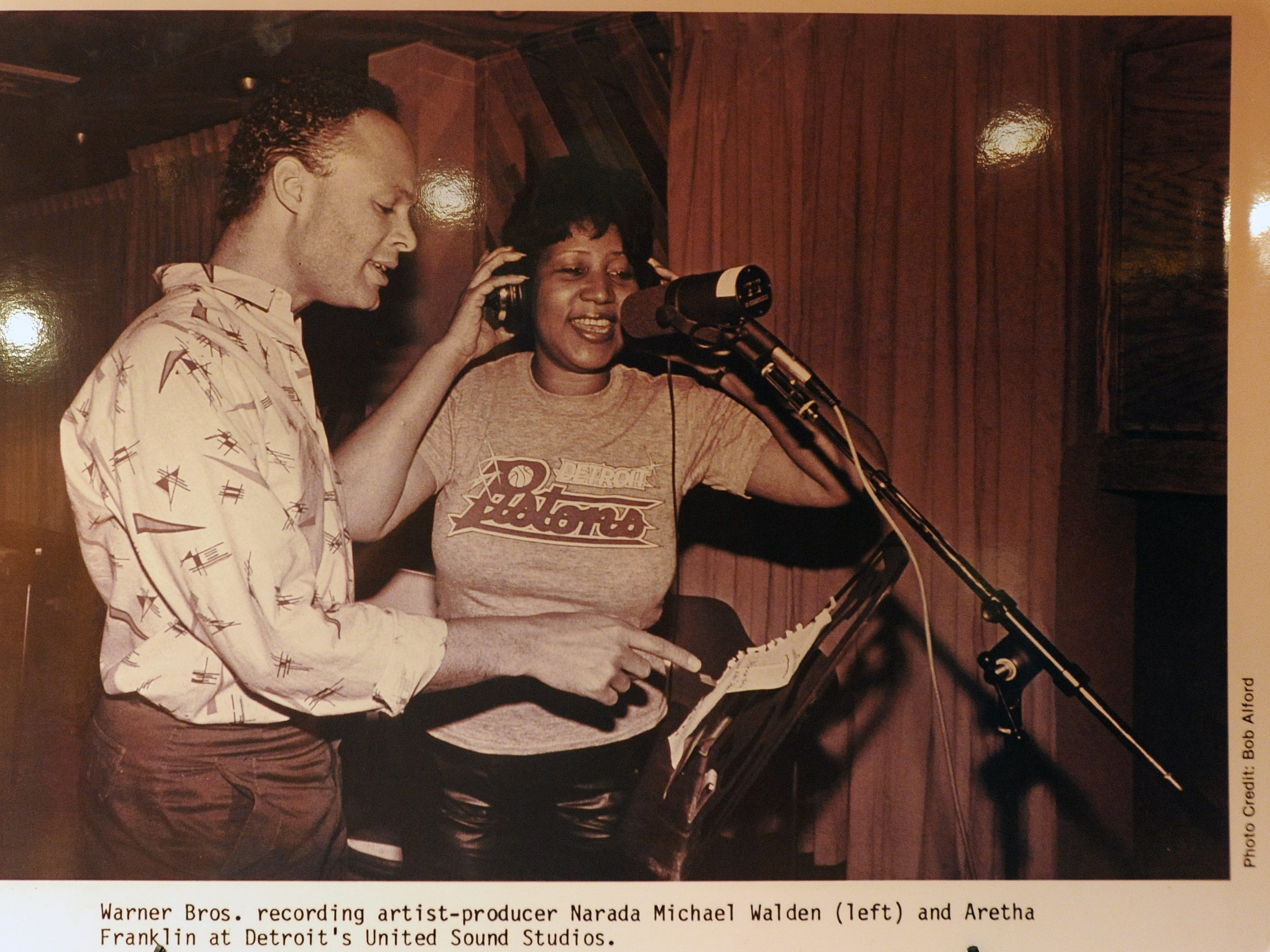 An old photo of Aretha Franklin singing with recording artist producer Narada Michael Walden.