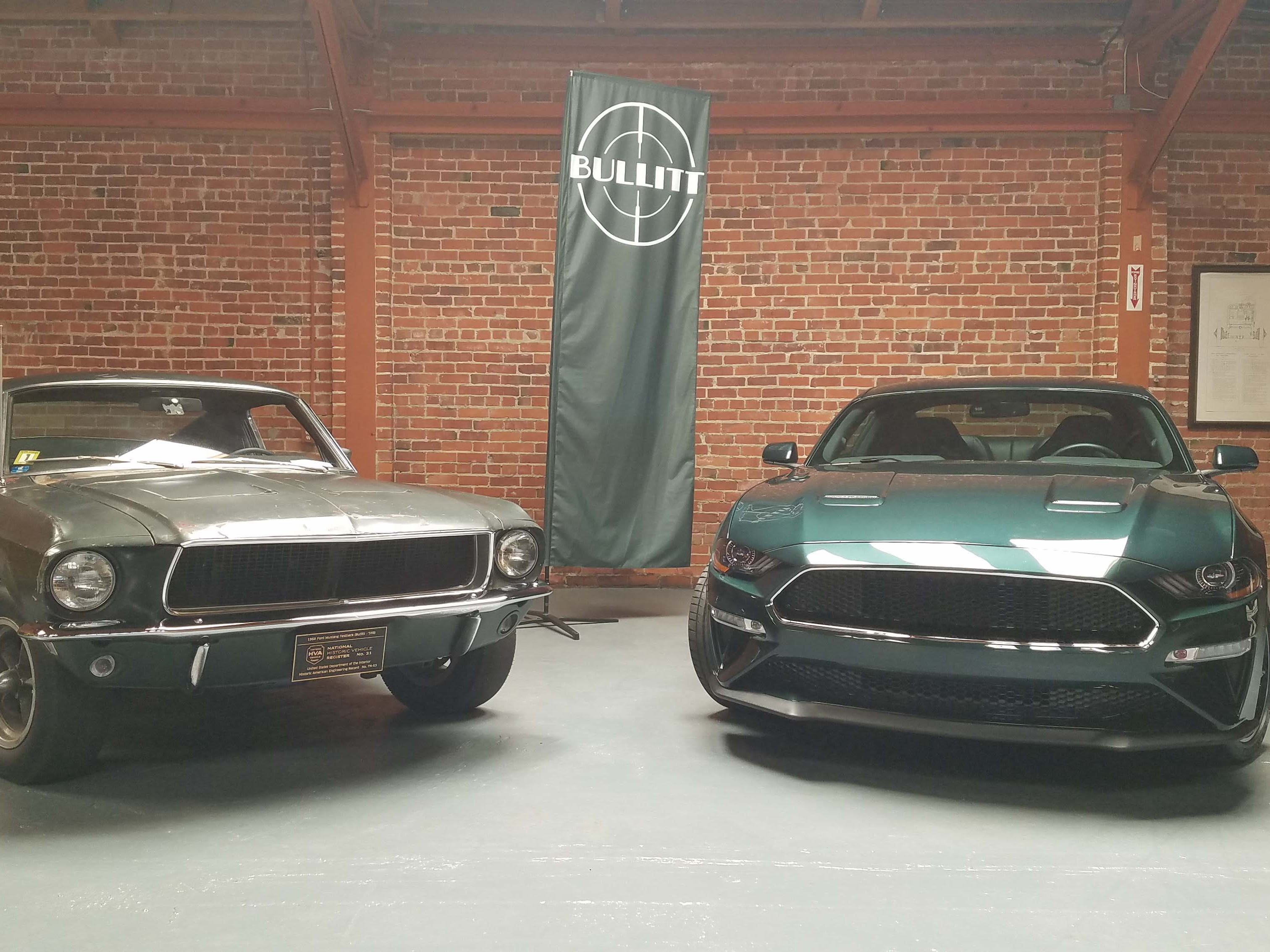 """Father and son. The original, 1968 Ford Mustang Fastback, left, driven by Steve McQueen in the classic car chase movie, """"Bullitt,"""" with the modern, 2019 Ford Mustang Bullitt. The family resemblance is unmistakable."""
