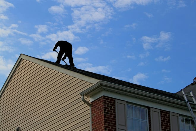 Roof inspections are a complicated and potentially dangerous job that should be undertaken by a licensed, bonded and insured contractor. (Dreamstime)
