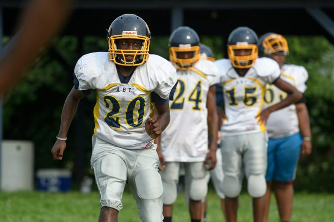 Senior wide receiver Dejuan Brown (20) is one of four returning starters on offense this season at Melvindale Academy for Business and Tech.